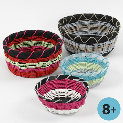 A basket made on a basket weaving template for Paper basket weaving template